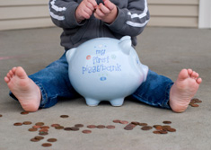 A boy with his piggy bank